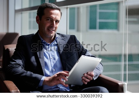 Business man working at VIP lounge at the airport - stock photo
