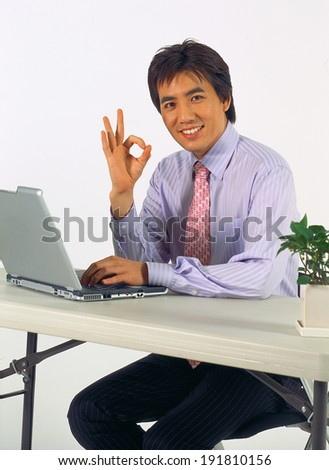 Business man working from laptop