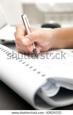 Business man working in his office - stock photo