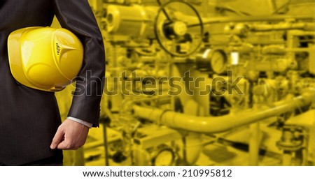 Business Man working in oil or gas refinery, turning on and off the pipeline valve torso and hand engineer yellow helmet for workers security construction worker No face Unrecognizable person - stock photo