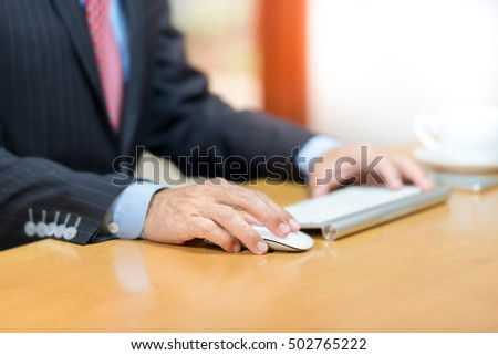 Business man working on computer,clicking mouse and keyboard,selective focus