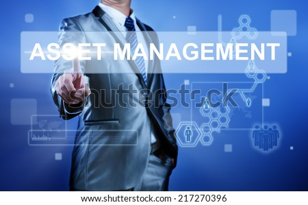 Business man working on digital virtual screen press on button asset management - stock photo