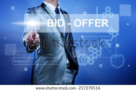 Business man working on digital virtual screen press on button bid - offer - stock photo