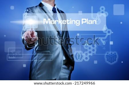 Business man working on digital virtual screen press on button marketing plan - stock photo