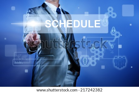 Business man working on digital virtual screen press on button schedule - stock photo