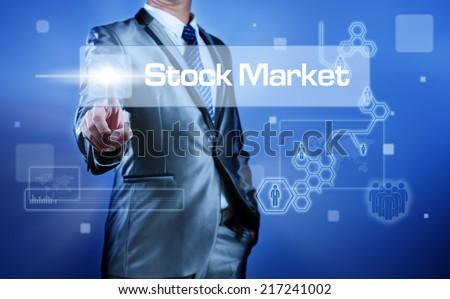 Business man working on digital virtual screen press on button stock market - stock photo