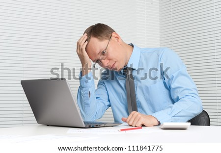 Business man working on his laptop computer