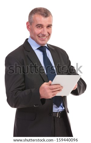 business man working on his tablet and smiling for the camera. on a white background