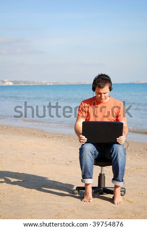 Business man working on the beach - stock photo