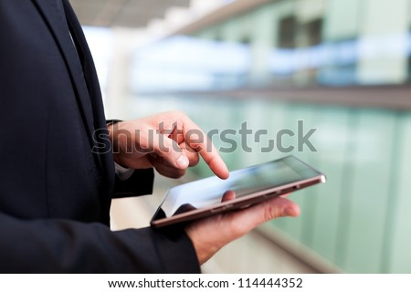 Business man working with a digital tablet - stock photo