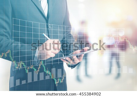 Business man working with a digital tablet with forex graph. - stock photo