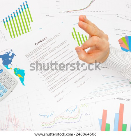 Business man working with financial data - OK sign - studio shot - stock photo