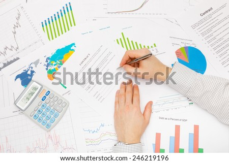 Business man working with financial data - preparing for signing contract - stock photo