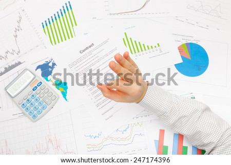 Business man working with financial data - showing OK sign - stock photo