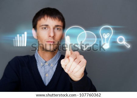 Business man working with his modern computer and virtual interface. Merge of technologies concept - stock photo