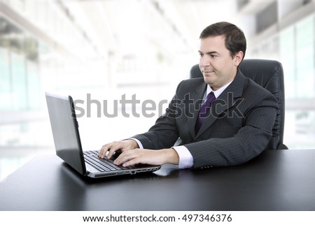 business man working with is laptop at the office