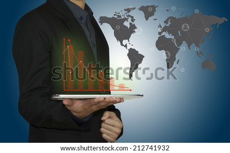 business man working with tablet computer show business graph. - stock photo