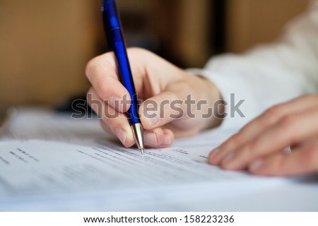business man works with documents in the office, paperwork - stock photo