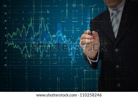 Business Man write graph on transparent digital screen - stock photo