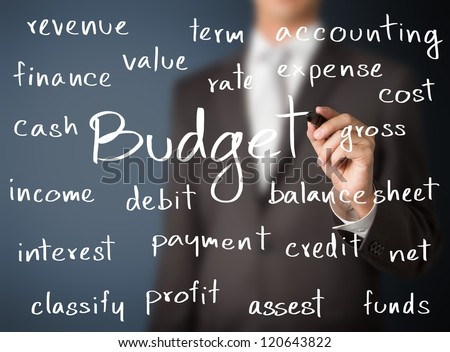 business man writing accounting concept of budget - stock photo
