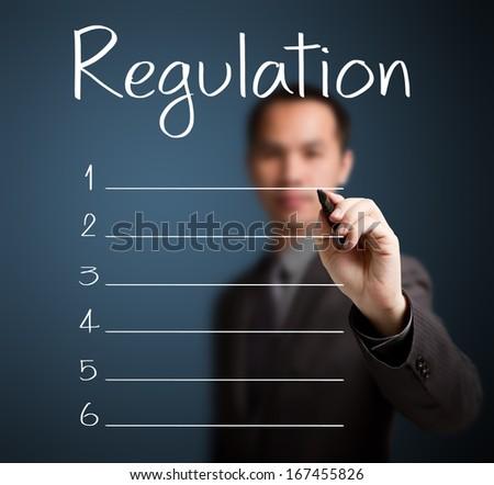 business man writing blank regulation list - stock photo
