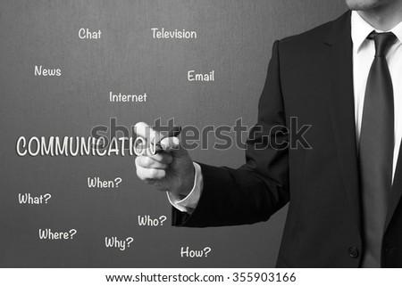 Business man writing communication concept - stock photo