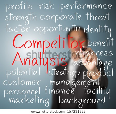 business man writing competitor analysis concept - stock photo