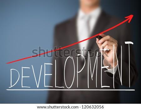 business man writing development graph - stock photo
