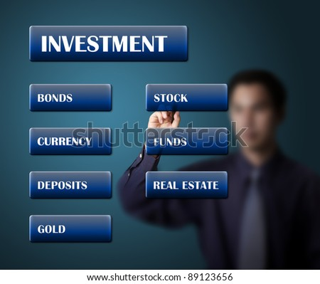 business man writing investment concept or investment plan on white board - stock photo