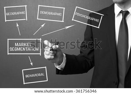 Business man writing Market segmentation, business management strategy - stock photo