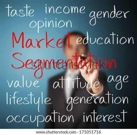 business man writing market segmentation concept