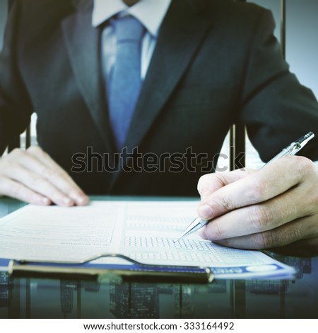 Business Man Writing On A Conference Table Concept - stock photo