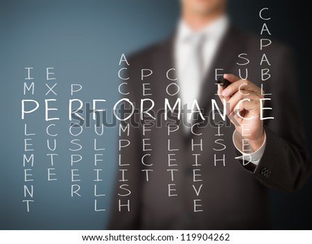 business man writing performance concept by crossword - stock photo
