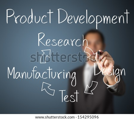 business man writing product development concept - stock photo