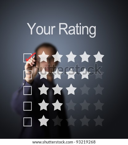 business man writing red mark on five star choice on rating survey form - stock photo