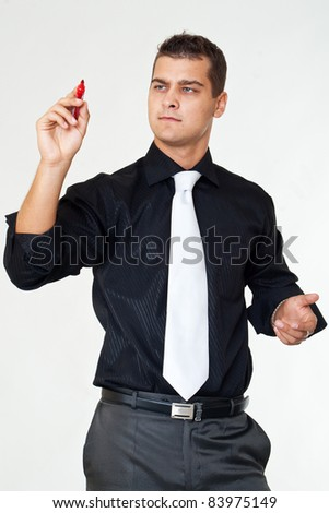 Business man writing something on glass board with marker - stock photo