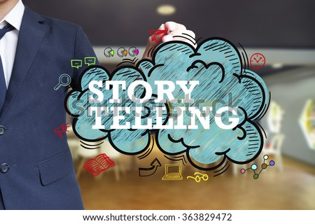 business man writing STORY TELLING over the cloud with office background , business concept , business idea - stock photo