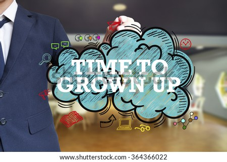 business man writing TIME TO GROWN UP over the cloud with office background , business concept , business idea - stock photo