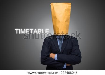 business man writing TIMETABLE  - stock photo