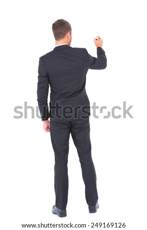 Business man writing with chalk on white background