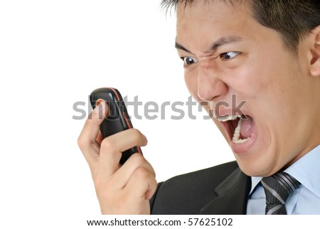 Business man yell to phone, closeup portrait of Asian with angry expression on face against on white background. - stock photo
