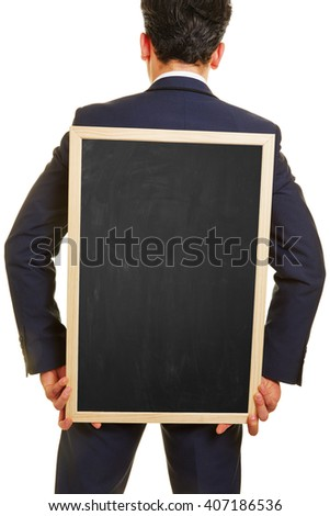 Business manager carrying empty blackboard on his back