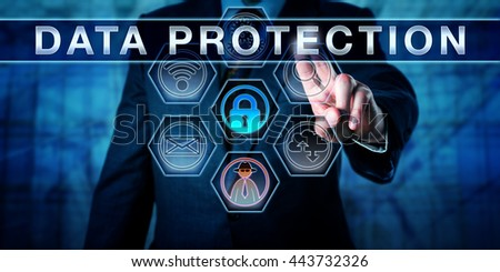 Business manager is pressing DATA PROTECTION on an interactive touch screen interface. Information privacy metaphor and corporate challenge concept for data privacy in networks and cyber space. - stock photo