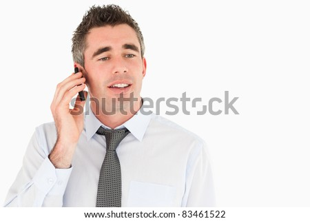 Business manager making a phone call against a white background