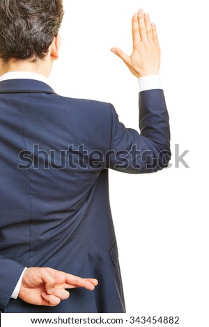 Business manager promising an oath with crossed fingers behind his back - stock photo