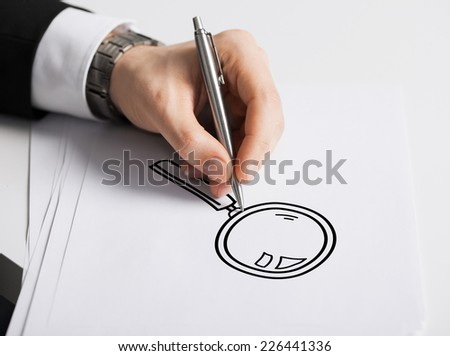 business, marketing, planning and people concept - close up of male hand with pen drawing lens on white paper - stock photo