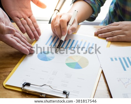 business meeting about graph focus on hand, Vintage tone, Retro filter effect - stock photo