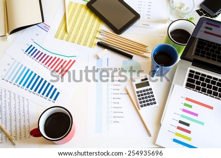 Business meeting, analyzing graphs, statistics and Business Plan - stock photo