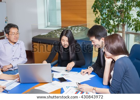 Business meeting, Asian people sitting for a table with business plan on high floor in the office. Asian nationality a woman and men watching business graph. - stock photo
