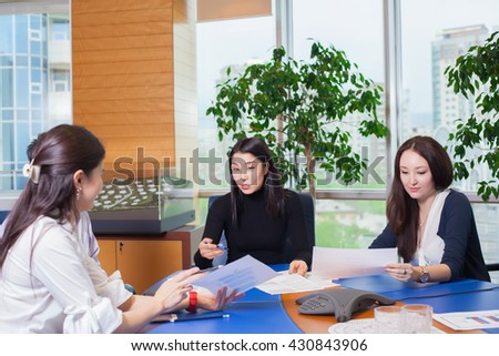 Business meeting, Asian people sitting for table with business plan on high floor in the office. business people negotiate - stock photo